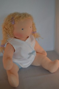 jointed doll sitting